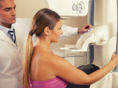 Traditional mammogram examination for detecting early stage breast cancer.